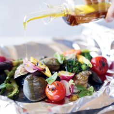 Foil packets for grilling preserve every drop of the delicious seafood juices.