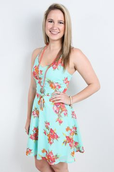 """Have some fun this summer in our """"Mint Majesty"""" dress! Floral and chiffon are always a classy combo, so throw on your favorite pair of neutral heels and go enjoy the sunshine! Shop our TOPS collection"""