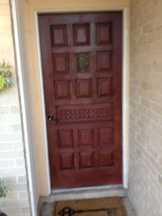 Annie Sloan Primer Red paint with dark wax on our front door. Turned out beautifully!