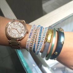 Who doesn't love a little glitz and glamour? Michael Kors rose gold watch, Chan Luu wrap bracelet, and Alexis Bittar bracelets.