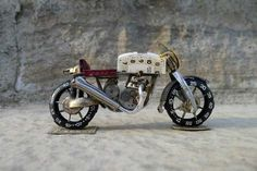 watch parts > awesome opossum motorcycle sculptures. Dan Tanenbaum from Toronto Canada builds some sweet Cafe Racers using the intricate parts from old timepieces. #upcycle #watches