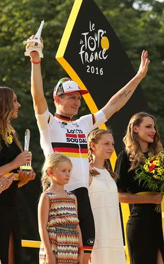 Andre Greipel of Germany and Lotto Soudal celebrates on the podium with his daughters Sophia Anna Greipel Luna Malou Greipel winning…