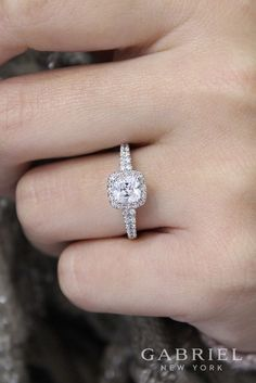 Gabriel - 14k White Gold Cushion Cut Halo Engagement Ring. A softened diamond halo forms a romantic pair with a cushion cut center stone in this timeless engagement ring. A row of carefully selected accent diamonds enhances the white gold band.