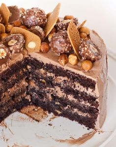 Do you enjoy the chocolate and hazelnut flavors of the popular Ferrero Rocher candy? You'll love those same flavors in this Ferrero Rocher cake made with hazelnuts, Frangelico, chocolate and Nutella! For this cake, I add pieces of waffle cookies for extra crunch and frost the outside of the cake with a Nutella buttercream! It's […]