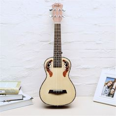 62.99$  Buy here - http://aliovx.worldwells.pw/go.php?t=32776842722 - 23/26 Inch Natural Color Grape Hole Spruce Wood Ukulele 4 strings Rosewood fretboard Ukulele Small Guitar Musical Instruments 62.99$