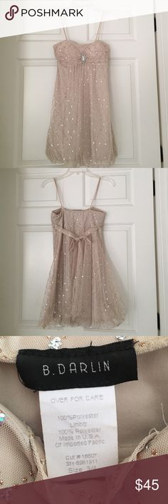 Champagne Sparkly Dress Beautiful champagne colored sparkly dress with rhinestone piece in the top middle. Would be perfect for a NYE party! Size 3/4 in juniors- fits like a 0/2 in women's.                                         •open to offers• B. Darlin Dresses
