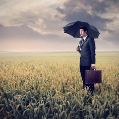 Sad Businessman by ollyi. Young mulatto businessman holding a black umbrella in a large field China Garden, Black Umbrella, Travel Photography, Sad, Stock Photos, Berry, Blog, Psicologia, Bury