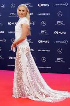 Lindsey Vonn wearing a sheer white gown by Atelier Zuhra on the red carpet at the Laureus Awards in Monaco, Feb. 18, 2019. #lindseyvonn #redcarpet #celebrity #fashion Lindsey Vonn, White Gowns, Red Carpet Looks, Red Carpet Fashion, Monaco, Awards, Celebrity, Formal Dresses, How To Wear