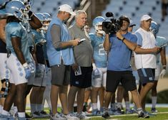North Carolina's Mack Brown held a football practice Monday night and invited guests to Kenan Stadium -- North Carolina students and fans. It was an open practice, a rarity these days for most coaches. Moving To North Carolina, Michael Carter, Defensive Back, Carolina Hurricanes, Tight End, Running Back, Chapel Hill, Monday Night, One Team