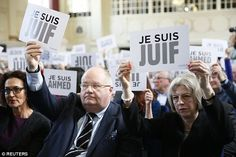 Communities Secretary Eric Pickles and Mrs May hold up signs declaring 'Je suis juif' ... 'I am Jewish'. What a deeply embarrassing display of subservience to a self-worshiping cult. Pickles and May are supposed to be servants of the people of the United Kingdom. Were the people consulted before this media-friendly stunt was pulled?