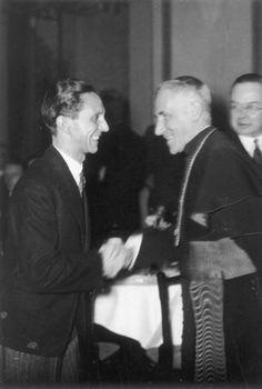 Cesare Orsenigo shaking hands with Joseph Goebbels, Berlin, 1934. (via indesirableprincesse)