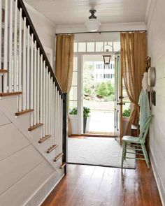 Love the curtains over the door.