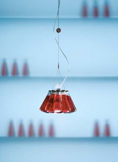Campari lamp (Raffaele Celentano, 2003): a pendant lamp with a shade comprising ten original Campari Soda bottles.
