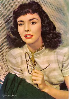 Jennifer Jones with super cute curled bangs and curled shoulder-length style
