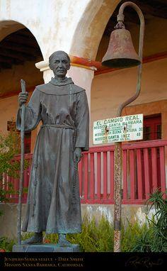 Statue of Father Junipero Serra and the original El Camino Real bell at Mission Santa Barbara, Santa Barbara, California