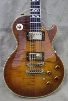 '78 LES PAUL 25/50 Anniversary, First and Limit Editions Color with two number (# 0677) Rare Violin Burst, Walnut, 2 Original Gibson Super Humbucking pickups, very nice flammed top and neck, KALAMAZOO MADE EX+ code GI715