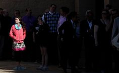 """Eleven-year-old Jane Linehan, of Bay Village, stands in beam of sun as she waits to get in to see the Cleveland area premiere of """"Captain America: The Winter Soldier"""" Tuesday, April 1, 2014, at the Cinemark Theaters in Valley View. (Joshua Gunter, The Plain Dealer)"""