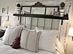 Make a headboard out of a large old window and add a few accents~ this lady's house is awesome. So many great repurpose decor ideas!