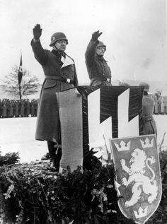 The commander of the 14. Waffen Grenadier Division der SS Galicia (ukrainische Nr 1) SS-Oberführer Fritz Freitag (left) with a Ukrainian translator at a swearing in ceremony for Ukrainian soldiers who finished their military training, winter of 1943-1944.
