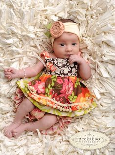 Love the entire image...great blanket and baby outfit!