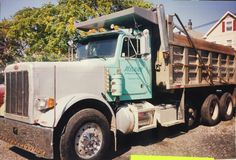 My husband's dump truck. He's ready for a tractor trailer now. How wonderful! I'm a proud trucker's wife!!