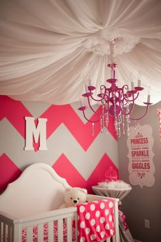 Obsessed with the pink, chevron, ceiling of tulle, and the chandelier! Love!