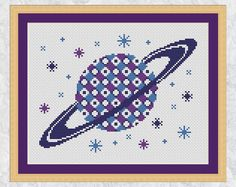 Saturn cross stitch pattern space counted by ClimbingGoatDesigns