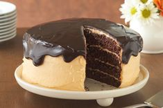The hint of orange flavour in the cream cheese frosting is a perfect complement to this melt-in-your-mouth glazed chocolate cake.