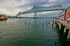 Astoria Megler Bridge, Columbia River  As seen from Columbia River waterfront in Astoria, Clatsop County, Oregon. This bridge was formally opened August 27th, 1966. It stretches 4.1 miles across the mouth of the Columbia River to connect western Oregon with western Washington state.