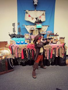 Pirate Themed Birthday Party - love the shop mast and blue skies backdrop! #kidsparty #partyidea