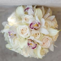 Orchids, mini calli lilies, and ivory roses... my bridal bouquet :)