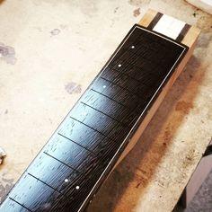 Wenge fretboard with thin costs of Tru-oil. #luthier #guitarmaker #guitarbuild #guitar #twitter #woodwork #customguitar #uniqueguitars #boutiqueguitars #madeincanada #mtl #wenge #truoil #fretboard #guitarsofinstagram #woodporn