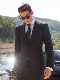 Awesome hair and struttin' in a suit like a boss! ~ Kim Woo-bin