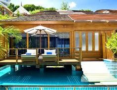 """KC Resort & Over Water Villas Koh Samui, Thailand - $299 per night.  Its 16 """"over water villas"""" are each set on stilts above a large and private infinity-edge pool, so guests can swim beneath their room or watch their partner through the glass floor in the bedroom area.  The service is excellent and the rooms are large and filled with high-end amenities, so if you just want the thrill of swimming beneath your own hotel room in Thailand this could be the perfect place."""