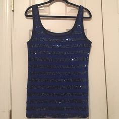 blue stripe sequin tank top Blue stripe sequin tank top. Never worn. Sequins are navy and only on the front of shirt. Old Navy Tops Tank Tops