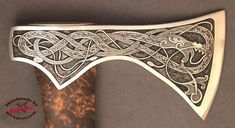 Midgard serpent ax - This is my last engraved ax.  I engraved the Midgard Serpent from Norse mythology.  It is deeply engraved, it took nearly two weeks to do the engraving.