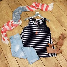 Take Me Away Striped Tank is a must have! This sleeveless, everyday tank top has contrasting stripes in navy and ivory.