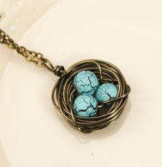 Fairly easy to do with large gauge wire wrapping -- copper and beaded stones.
