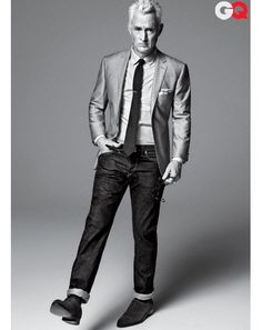 GQ Magazine April 2012 cover of John Slattery. Suit jacket, $325, and tie, $60, by DKNY. Shirt, $185 by Billy Reid. Jeans, $245 by Simon Miller Jeans. Shoes, $1,200 by John Lobb. Tie bar and pocket square by The Tie Bar. Belt by J.Crew. $2015   Photographed by Sebastian Kim