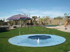 backyard splash pad and in-ground trampoline