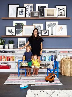 Home tour- Rebecca Minkoff's stylish and refreshingly modern apartment! Modern apartment of handbag designer Rebecca Minkoff designed by Alex Reid (via Mix and Chic). Picture Shelves, Picture Ledge, Picture Walls, Photo Ledge Display, Photo Displays, Display Photos, Shelf Display, Office Playroom, Blue Playroom