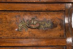 A Louis XV Provincial walnut bombe commode, mid 18th century. Serpentine top above undulating drawer fronts with snail scroll ornamentation on a conforming apron above scrolled cabriole feet, Circa 1750. height: 34 in. 86 cm., width: 49 in. 124.5 cm., depth: 23 in. 58.5 cm. #rocaille #louisxv #frenchprovincial #louisxvfurniture #commode #vintagecommode #frenchantiques #sf #sanfrancisco #hardware #ornamentation #interiordesign