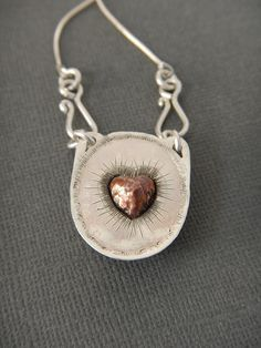 back view of sea stone pendant with chased and repousse copper heart.