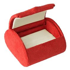 """Noble Gift Packaging's  """"Impression"""" collection of red jewellery boxes have a sleek, rounded silhouette that gives them a modern feel. These single ring boxes have a unique half moon shape, bound in plush suede, with white suede interiors."""