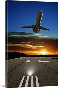 XL corporate jet airplane landing at sunset