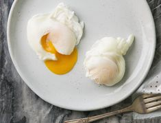 A successful poached egg requires a bit of mastery—the vinegar helps keep the egg together.