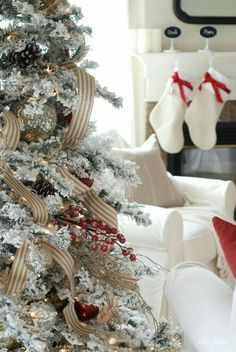 I need some striped christmas tree garland this year! Such a gorgeous Christmas living room with pops of red! by Ella Claire Flocked Christmas Trees Decorated, Christmas Mantels, Noel Christmas, Merry Little Christmas, Country Christmas, Christmas Tree Decorations, Christmas Crafts, Christmas Cookies, Christmas Wreaths