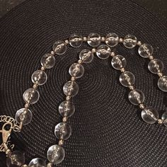 Dolce & Gabanna statement♥️Clear sIlvertone chain Large clear acrylic beads throughout  Small silvertone beads spaced throughout  Large lobster clasp closure with D&G charm and 2'' jump chain  Measures 36'' long with 14'' drop from neck Dolce & Gabbana Jewelry Necklaces