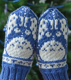 Free Knitting Patterns for Totoro Mittens - Norwegian style mittens inspired by the shy forest spirits portrayed in Hayao Miyazaki's Japanese animated film My Neighbor Totoro. Designed by brella, the stranded colorwork features a big Totoro with an umbrella, two little Totoros, and a bunch of dust bunnies (or soot sprites) .Pictured project by djaya. Some Ravelrers have adapted for hats, sweaters, and more.