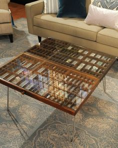 Great idea. We only have a couple hundred of these in the garage. DIY Collection Table ~ Showcase a variety of collectibles and objects in this DIY display case made with letterpress drawers from TV crafter Hosanna Houser. (i LOVE this idea, but not crazy about the table legs).